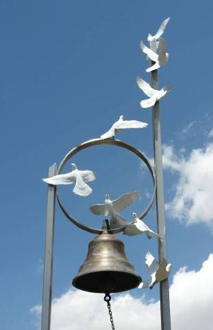 Bell and doves
